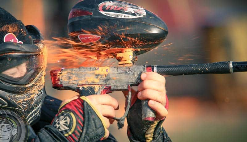 female playing paintball